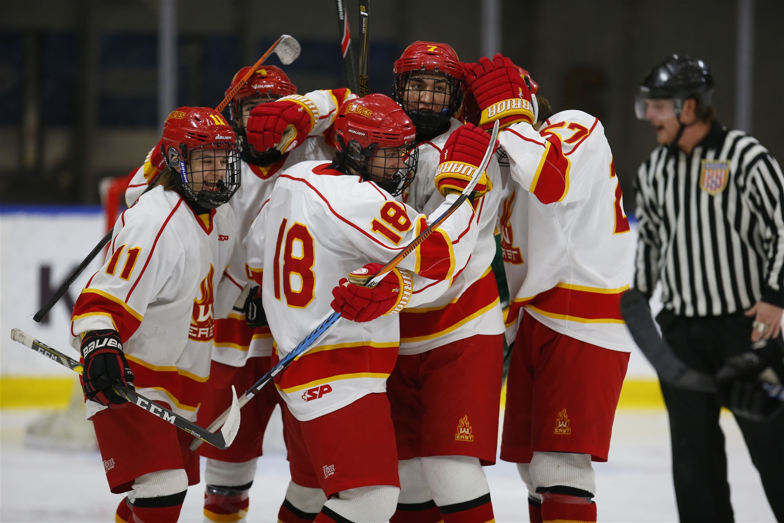 Williamsville East's Jack Kelly (18) is congratulated on his second goal of the game against West Seneca East during first period action.