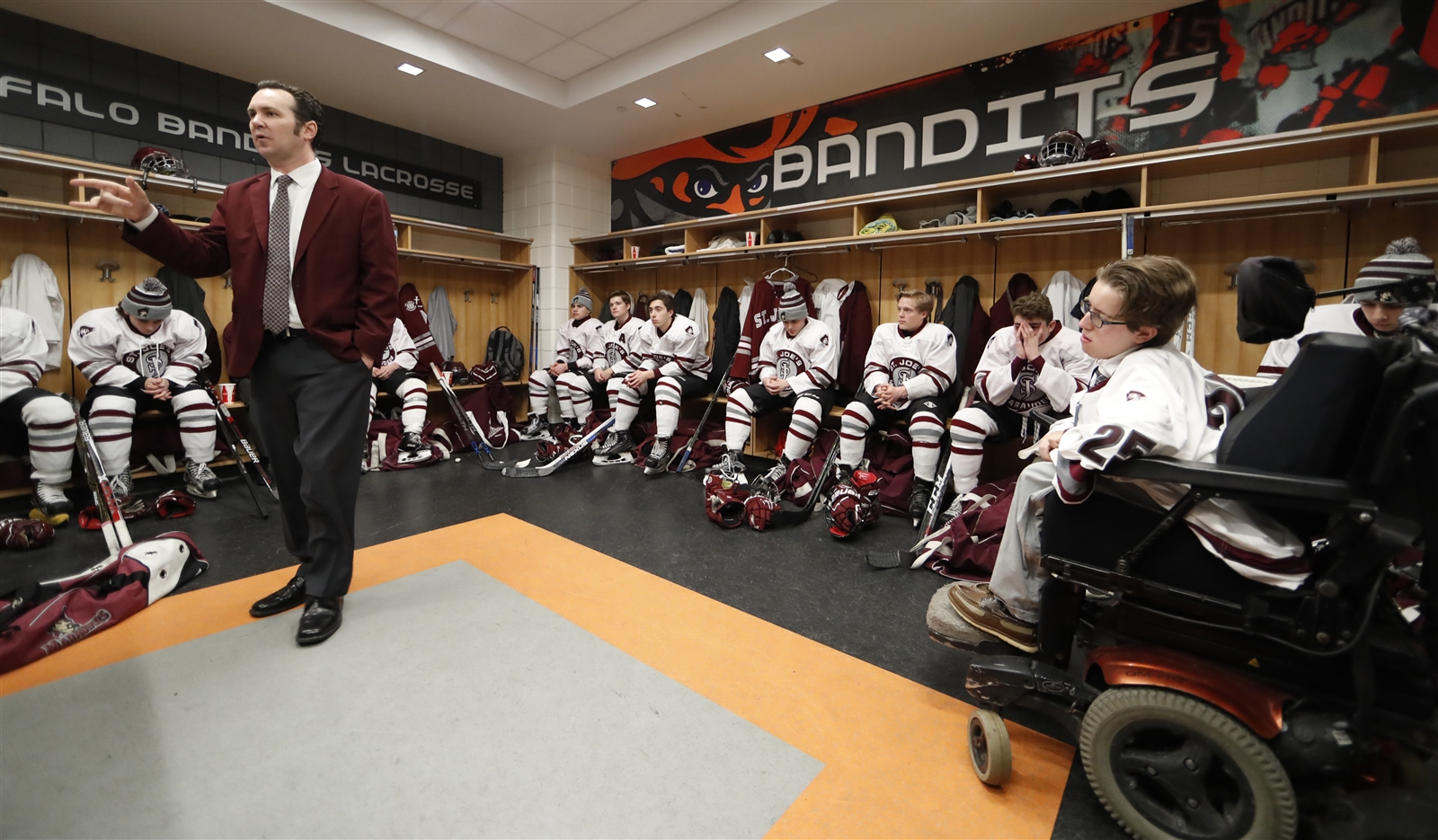 St. Joe's coach Richard Crozier addressed his team prior to playing Canisius for the Niagara Cup.