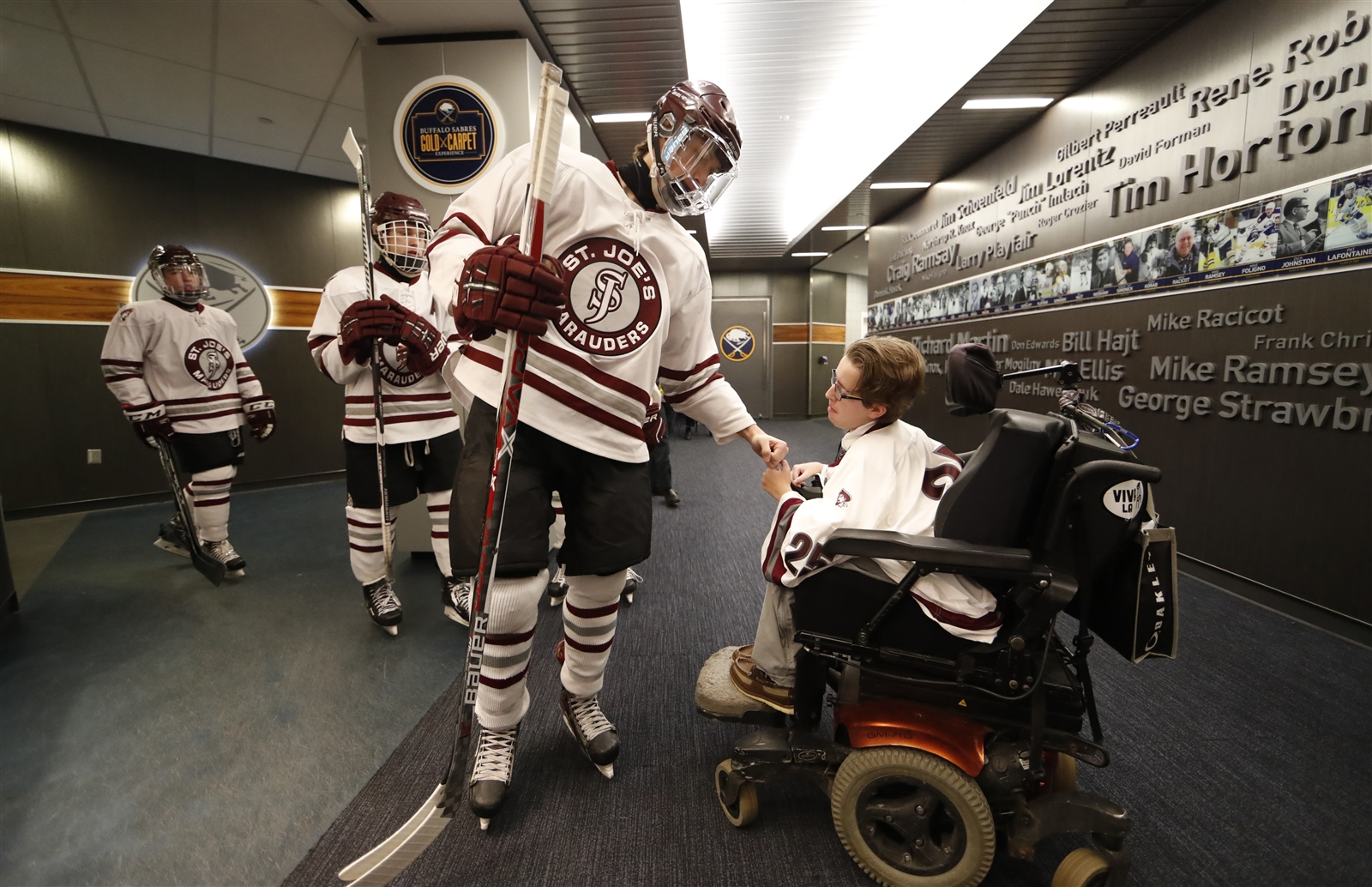 St. Joe's Nathan Berke gets a fist bump from Patrick Vetri, team manager.