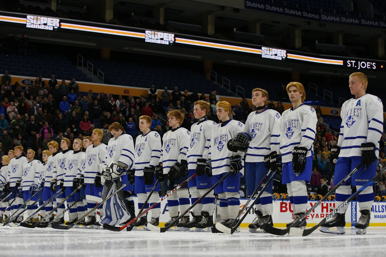 Kenmore West players stand for the National Anthem prior to playing West Seneca East for the Small School Section VI hockey championship.