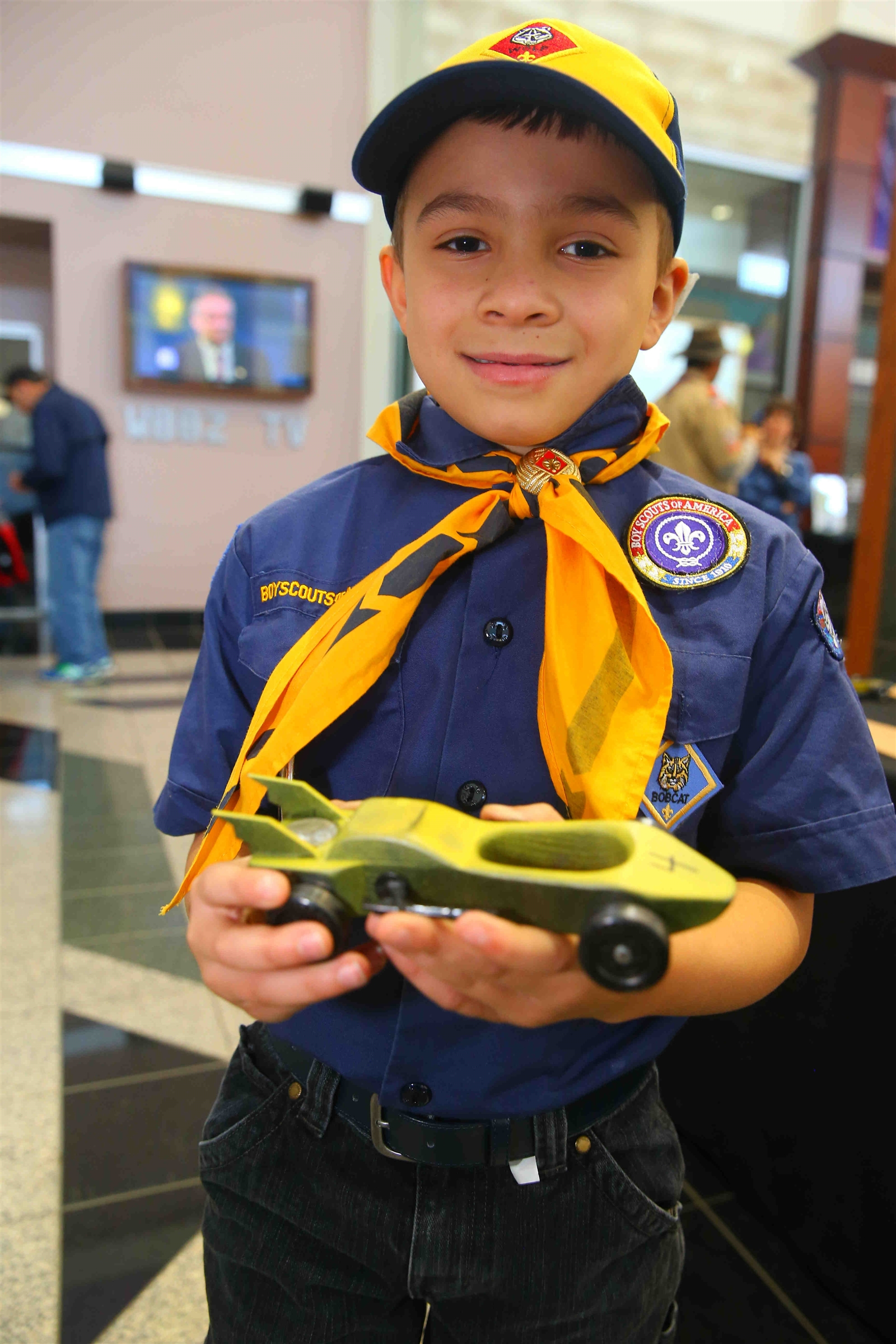 Bryce Ranalletta of Pack 563 , 7, holds up his pinewood car at the Onondaga Cub Scout Packs Pinewood Derby races.