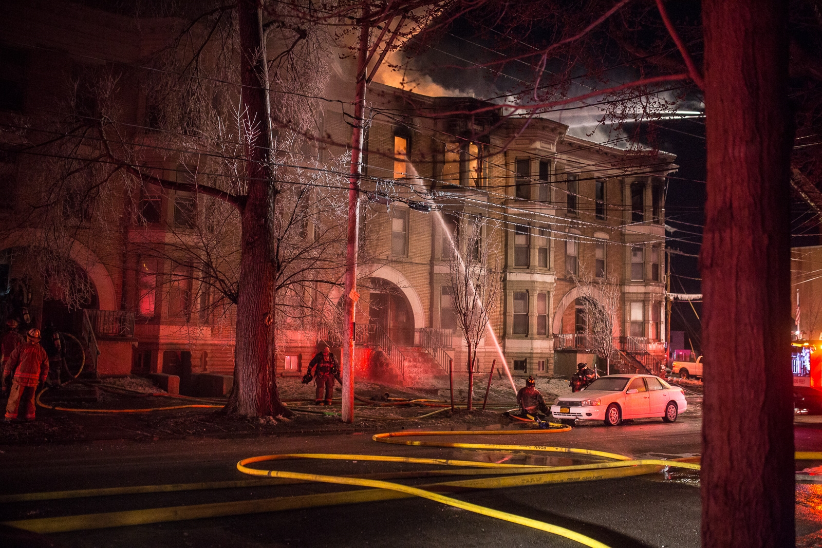 A fire overnight in a third-floor apartment sent 90 residents out into the cold overnight Saturday.