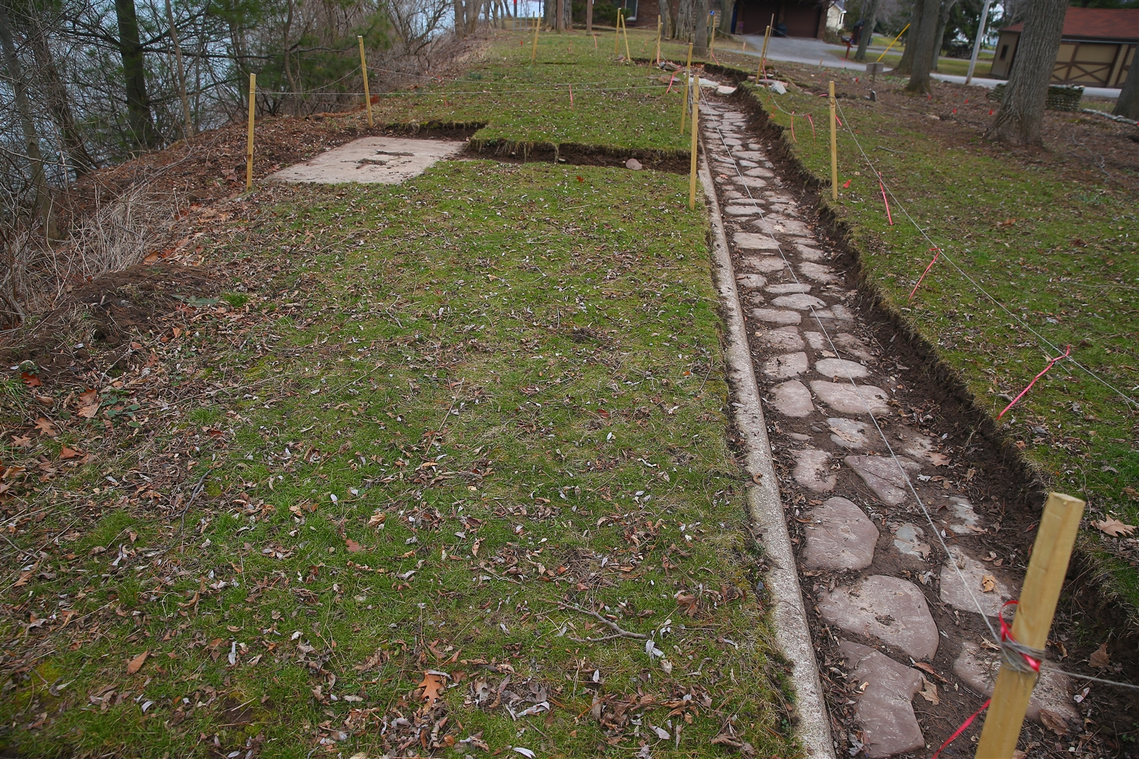 The excavated stone pathway has a small offshoot path that leads to what might have been a spot to place a small bench for a lake view. But without photos of the grounds, the Wertmans are guessing about what was where.
