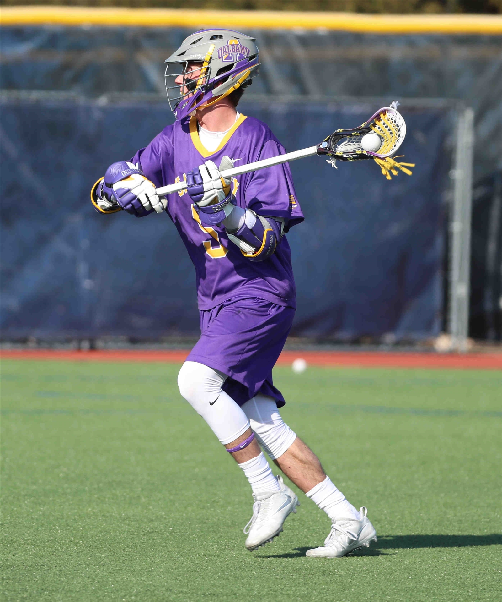 Albany's Connor Fields (5) brings the ball up the field.