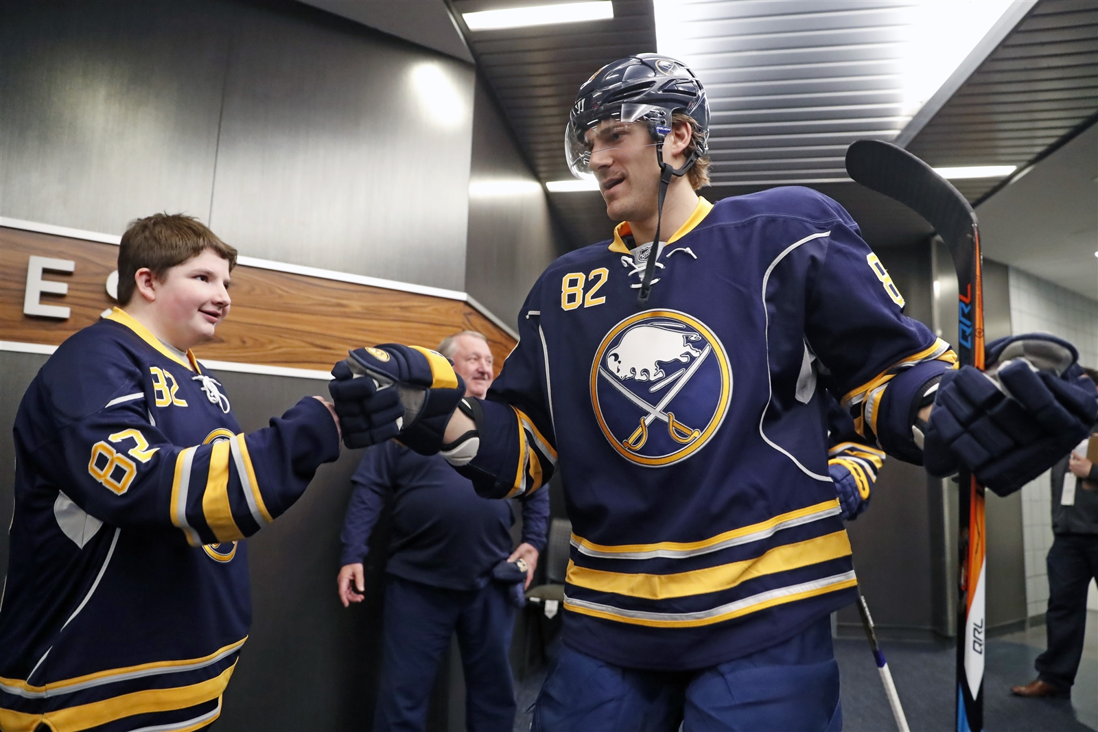 Buffalo Sabres' Marcus Foligno greets Zack Bouquard prior to playing the Montreal Canadiens..