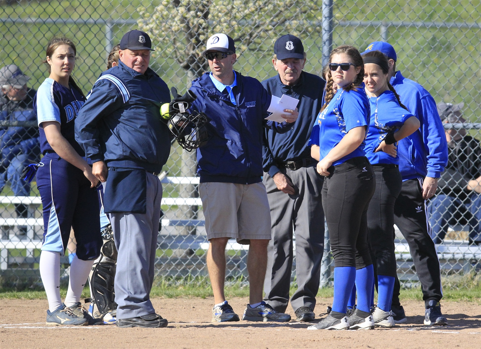 Umpires go over the ground rules with Depew and Alden prior to game action.