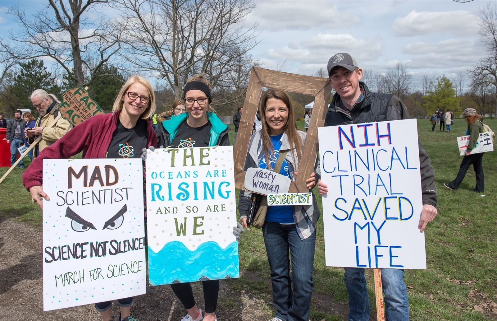 Four different messages from this group of marchers. The sign on the left is a call for action, the second from the left colorfully draws attention to global warming, the third echoes a slogan for female empowerment from the 2016 presidential election, while the final is a powerful personal message.