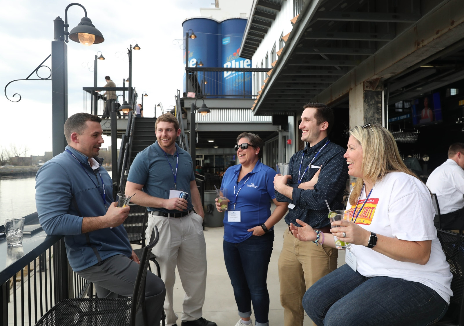 Coworkers and students from UB's MBA program hang out on the patio.  From left are Aaron Shaw, Edward Harof, Erin O'Brien, Briar Baker and Jaimie Falzarano.