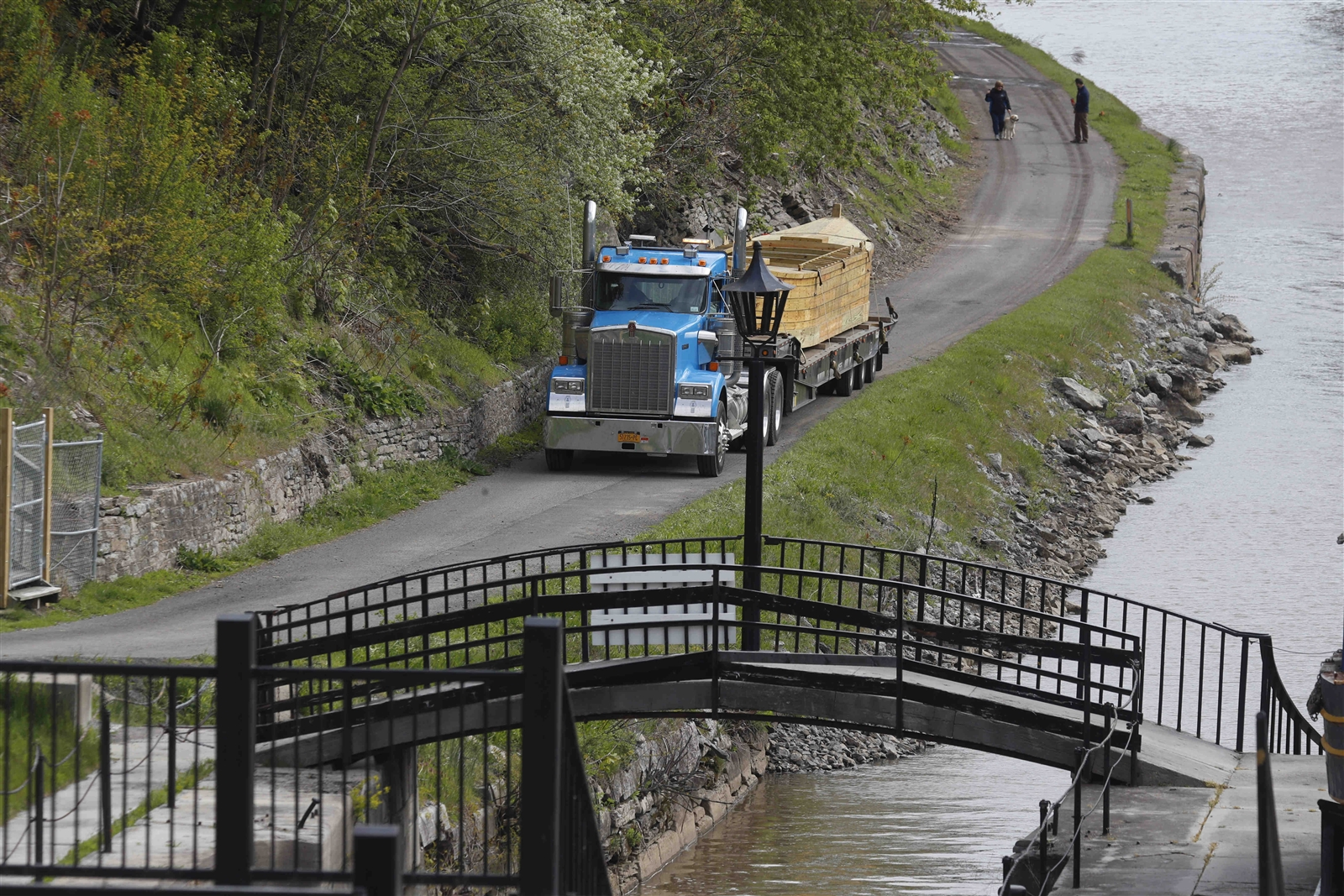 The Erie Traveler, a replica of a 19th century Erie Canal cargo boat, known as a Durham Boat, weighs 8 tons and was carried by flatbed truck to the Flight of Five locks on the Erie Canal in Lockport Thursday May 11, 2017.