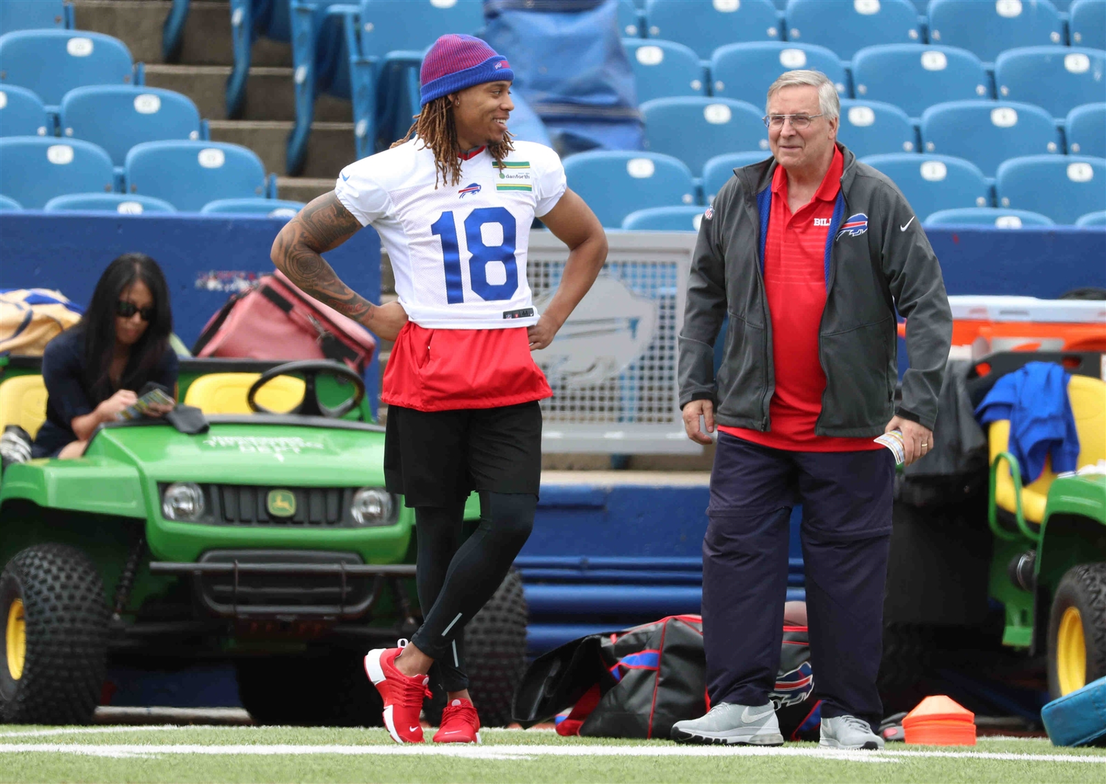 Kolby Listenbee and Terry Pegula watch the Buffalo Bills 2017 Rookie Minicamp from the sidelines.
