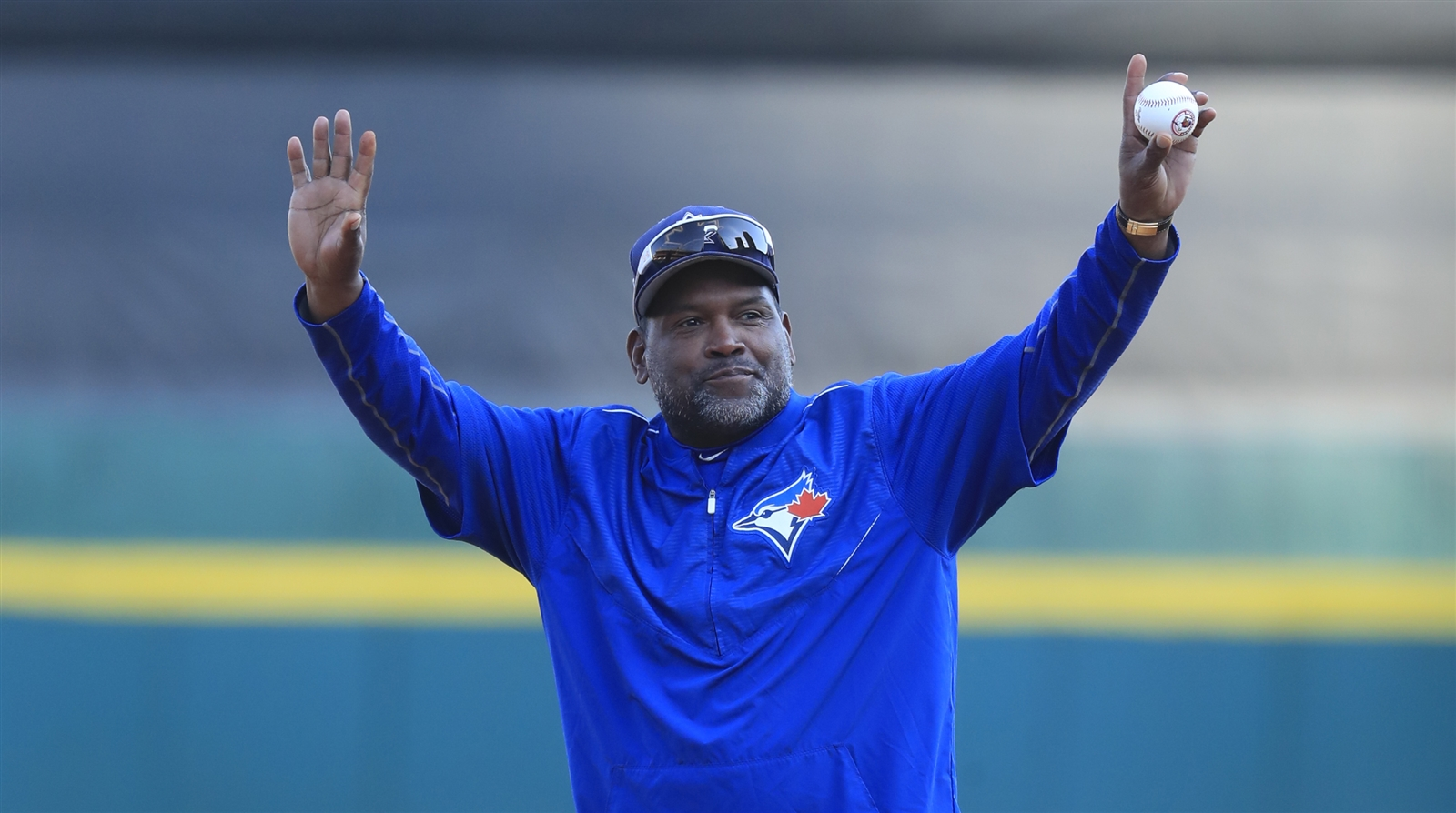 Tim Raines throws out a ceremonial first pitch.
