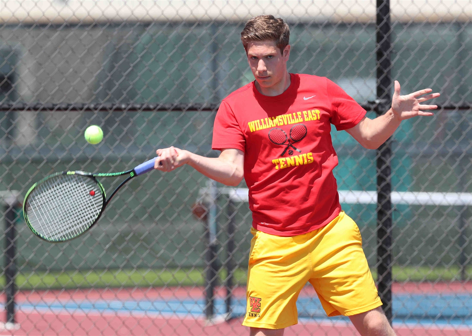 Williamsville East's doubles player Jason Berkun hits a shot.
