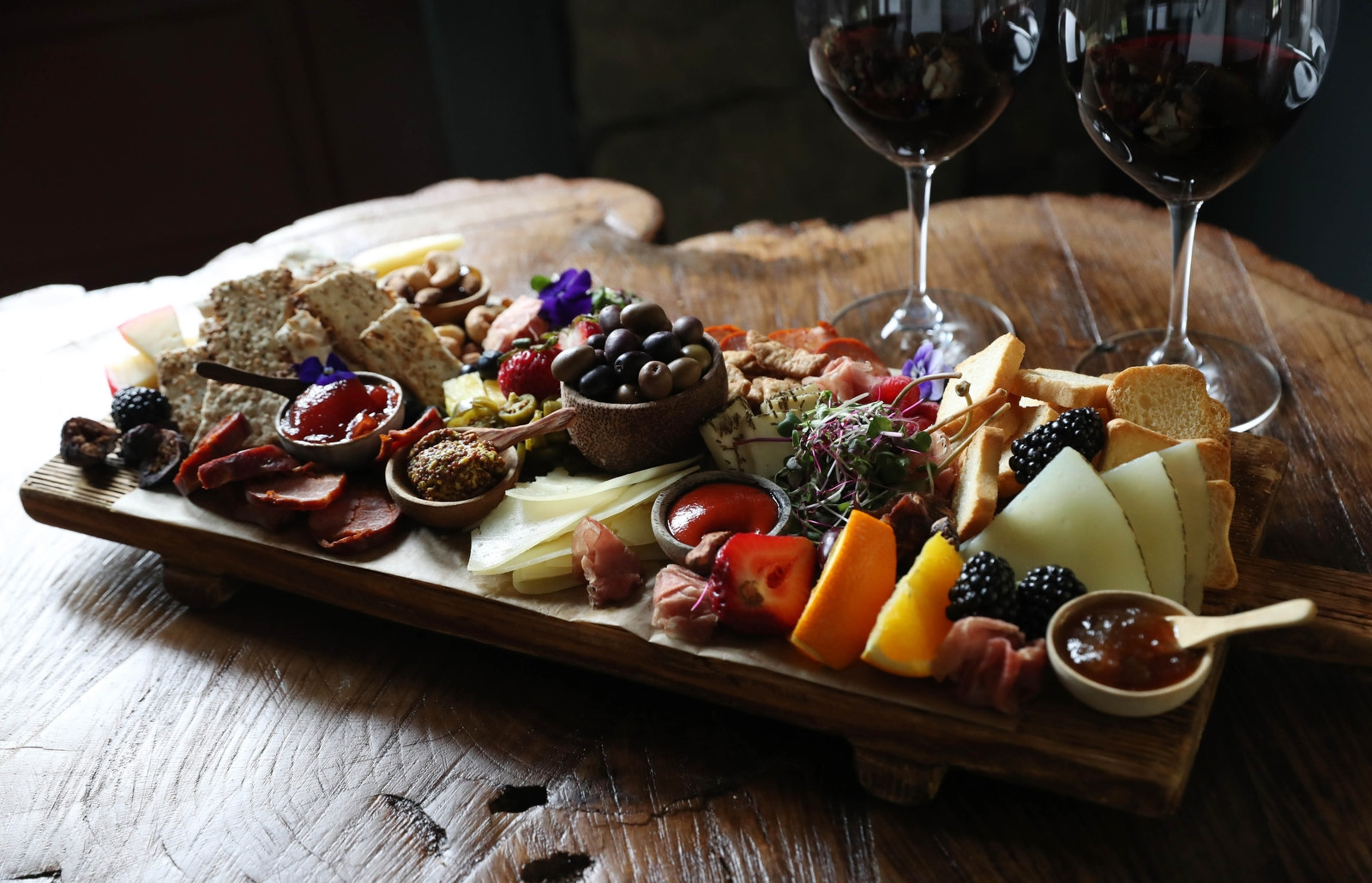 The Artisanal Chef's Board is designed to share. It includes sausages chourico, linguica and prosunto, cheeses from Portugal, jams and jellies, nuts, fruits, olives, bread and crackers.