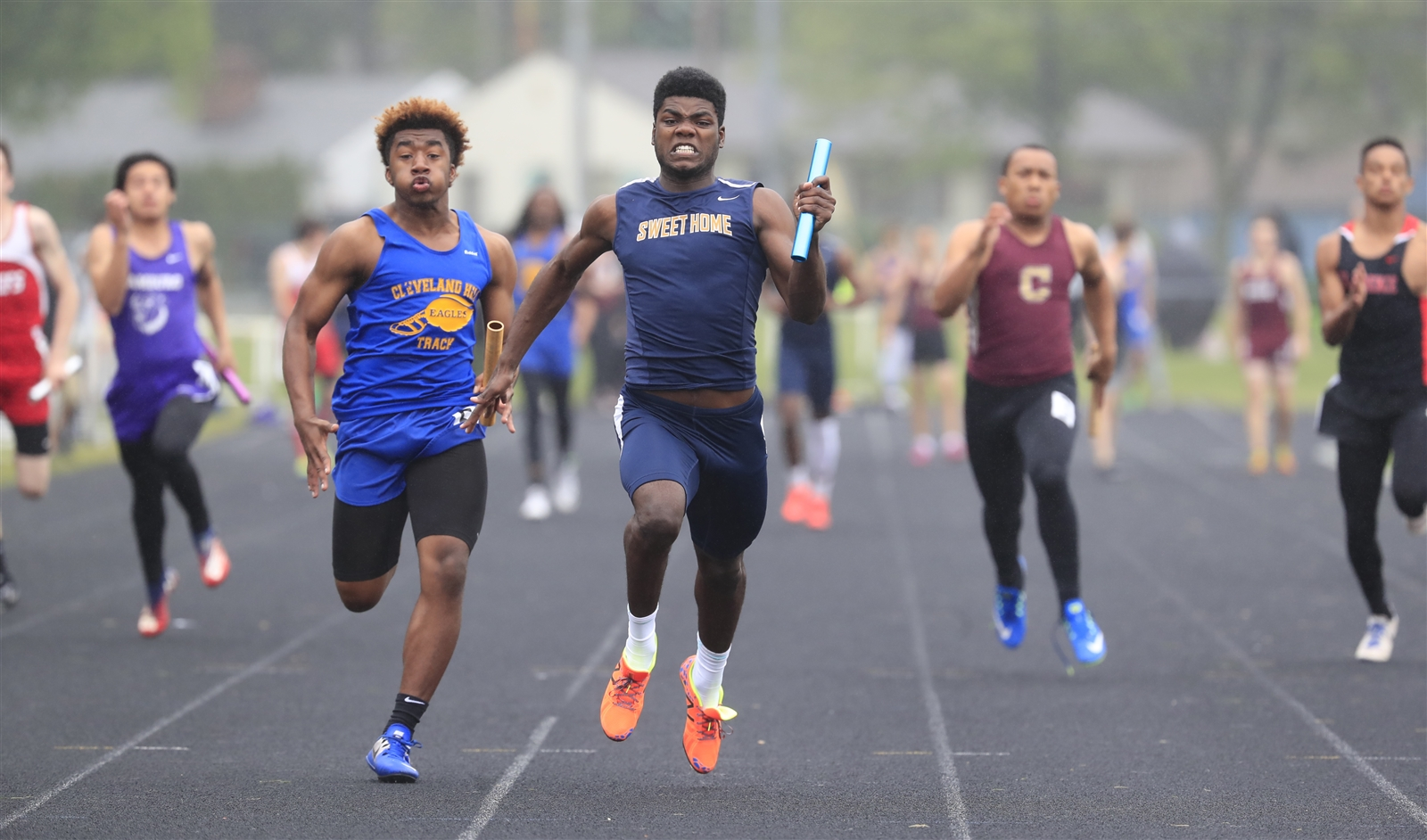 David Campbell from Sweet Home runs the last leg to victory in heat 1 of the 4x100 relay at the ECIC track championships at Hamburg high school on Friday, May 26, 2017.