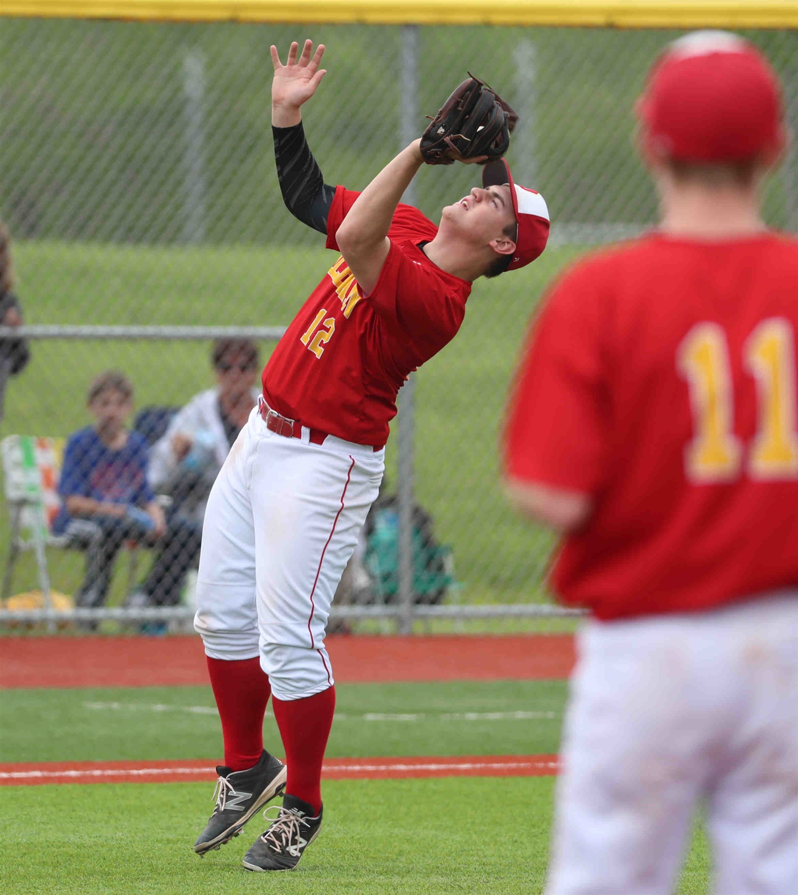 Olean's third baseman Zach Parr catches a pop up in the infield in the second inning.