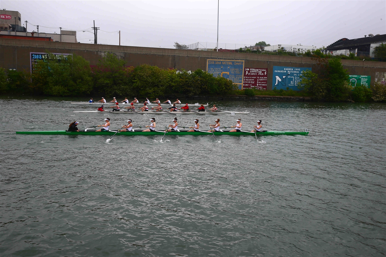 Girls in the JV8 at the start of their race compete in the Fontana All-High Regatta after a fog delay.