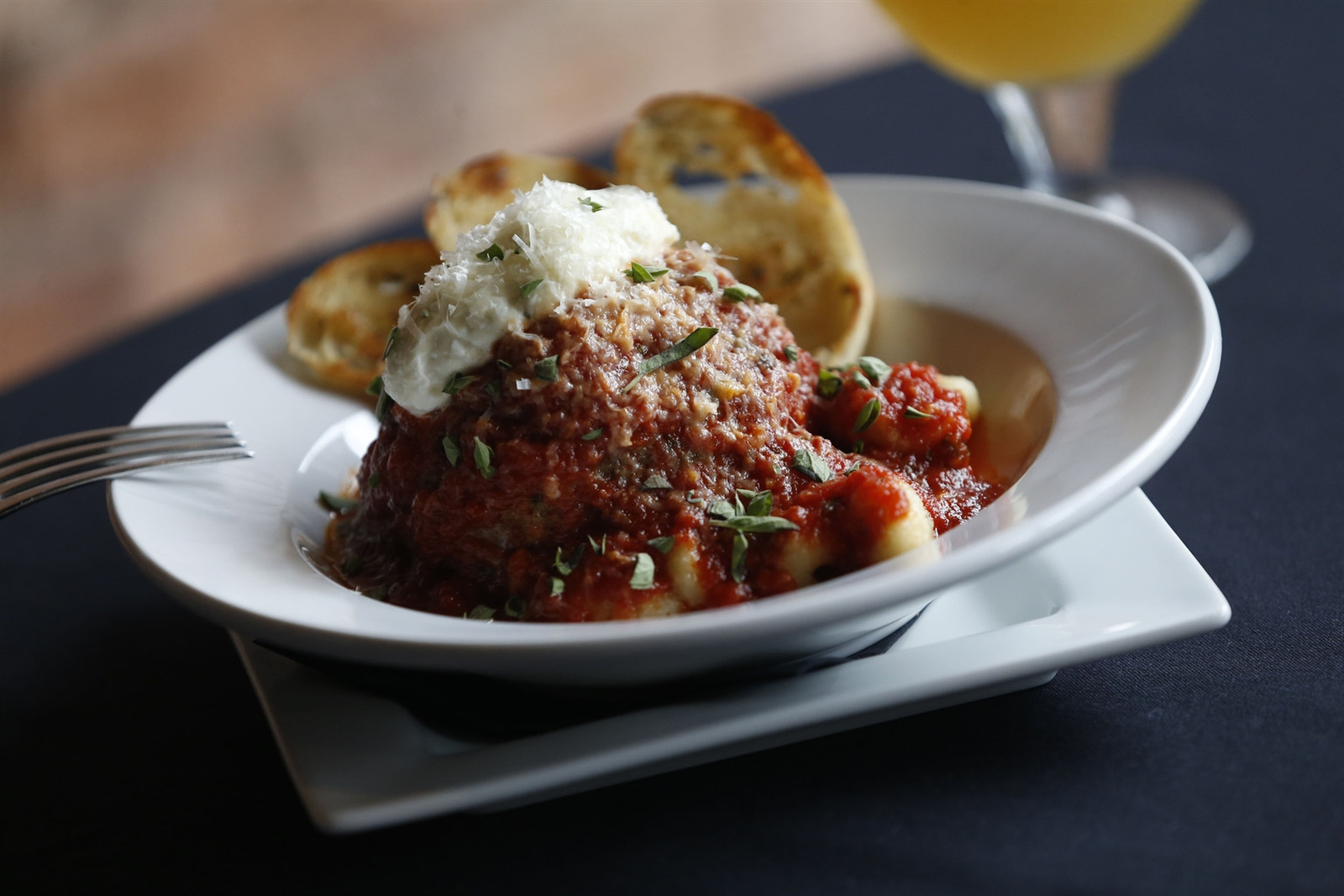 Canal Club 62's The Meatball is made from freshly ground beef and served with house marinara, ricotta, gnocchi and garlic crostini.