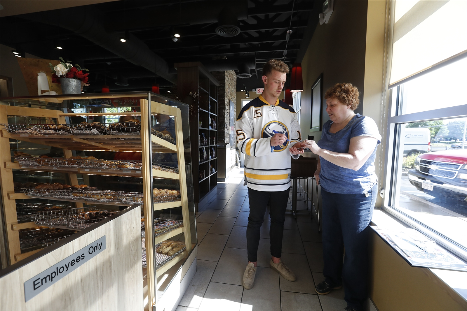 Buffalo Sabres forward Jack Eichel signs an autograph for Angie Schmitz at the Tim Hortons on Big Tree Road in Orchard Park on Wednesday, May 31, 2017.