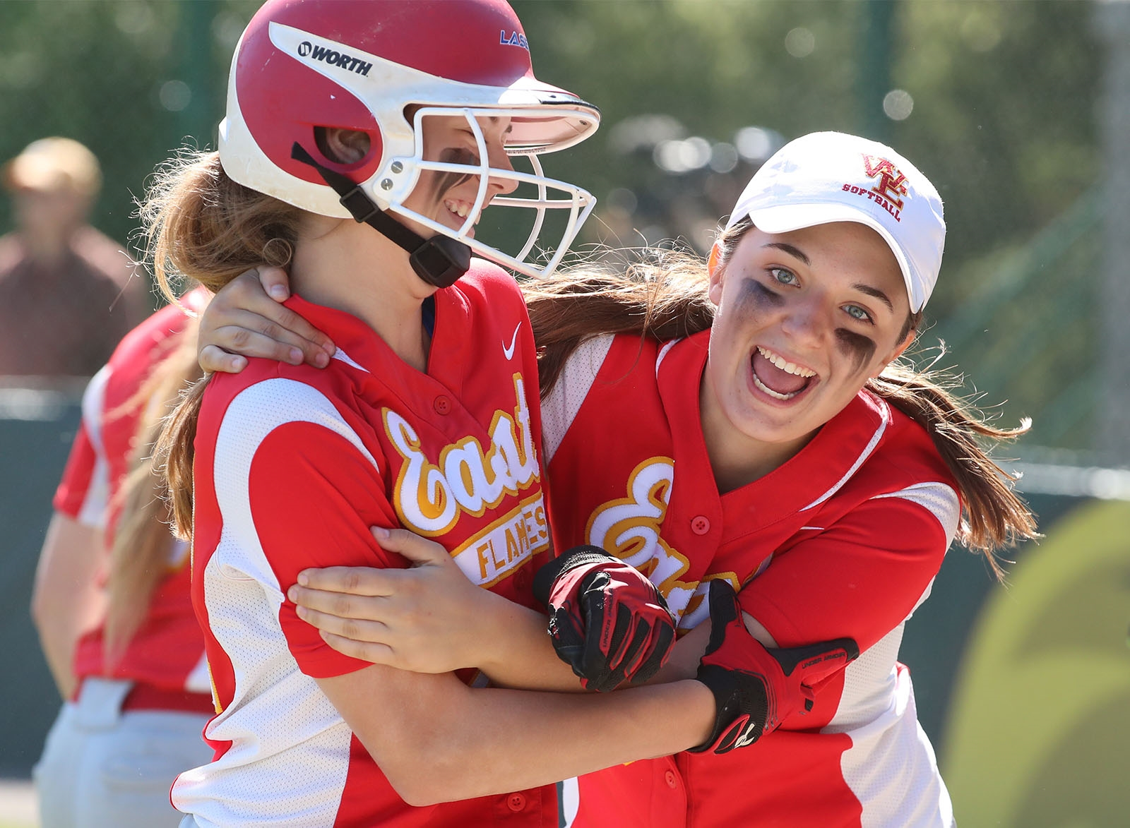 Williamsville East's Maddi Lawida hugs Maddy Miske after she scored a run in the third inning of the Far West Regional Class A softball Championship in Brockport.