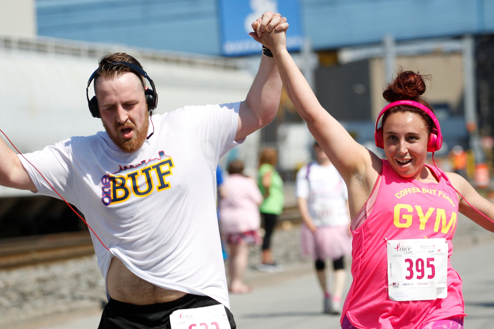 Ryan Boggs and his girlfriend Mary Bostwick cross the finish line as they complete the 5k race.