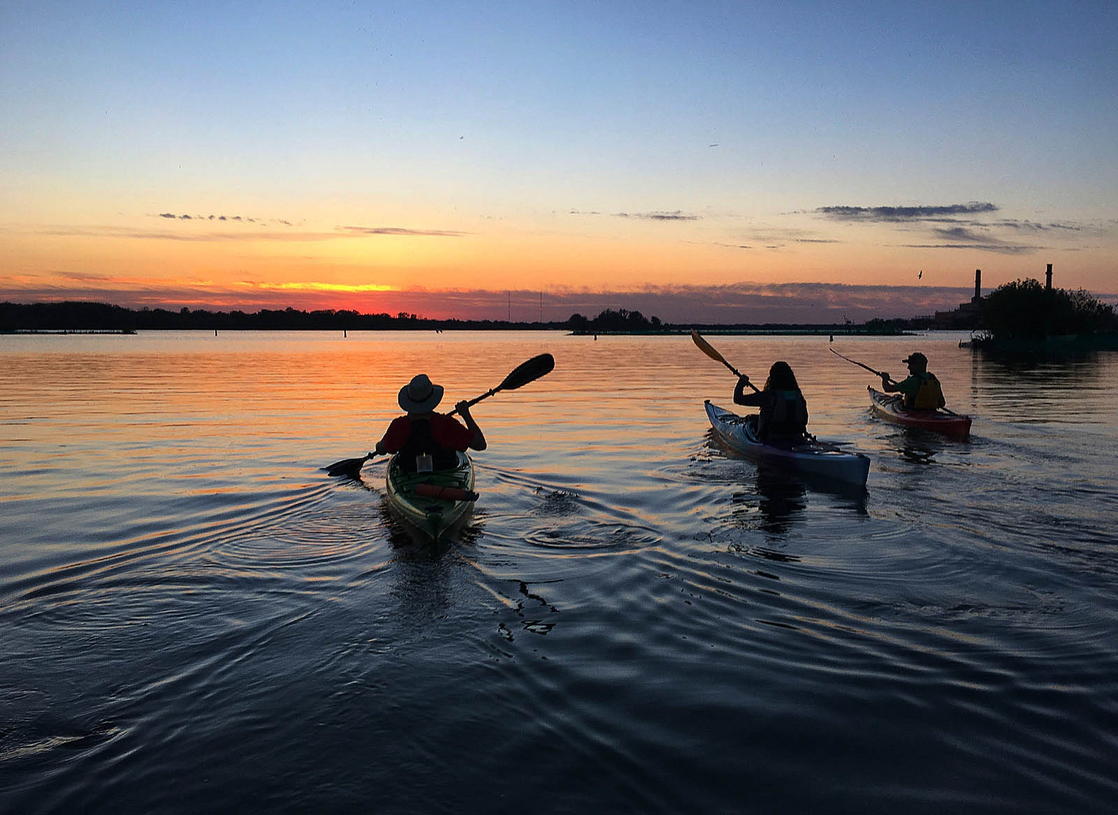 Kayakers on the Niagara River take in the sunset near Strawberry Island.