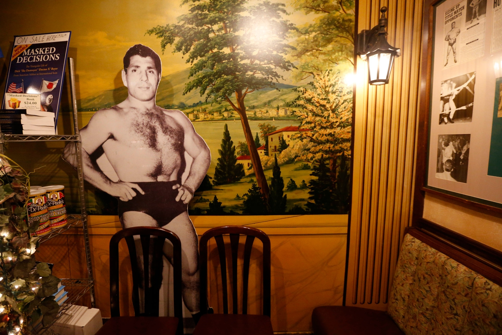 A large standup photo of Ilio DiPaolo greets customers as they enter the restaurant.