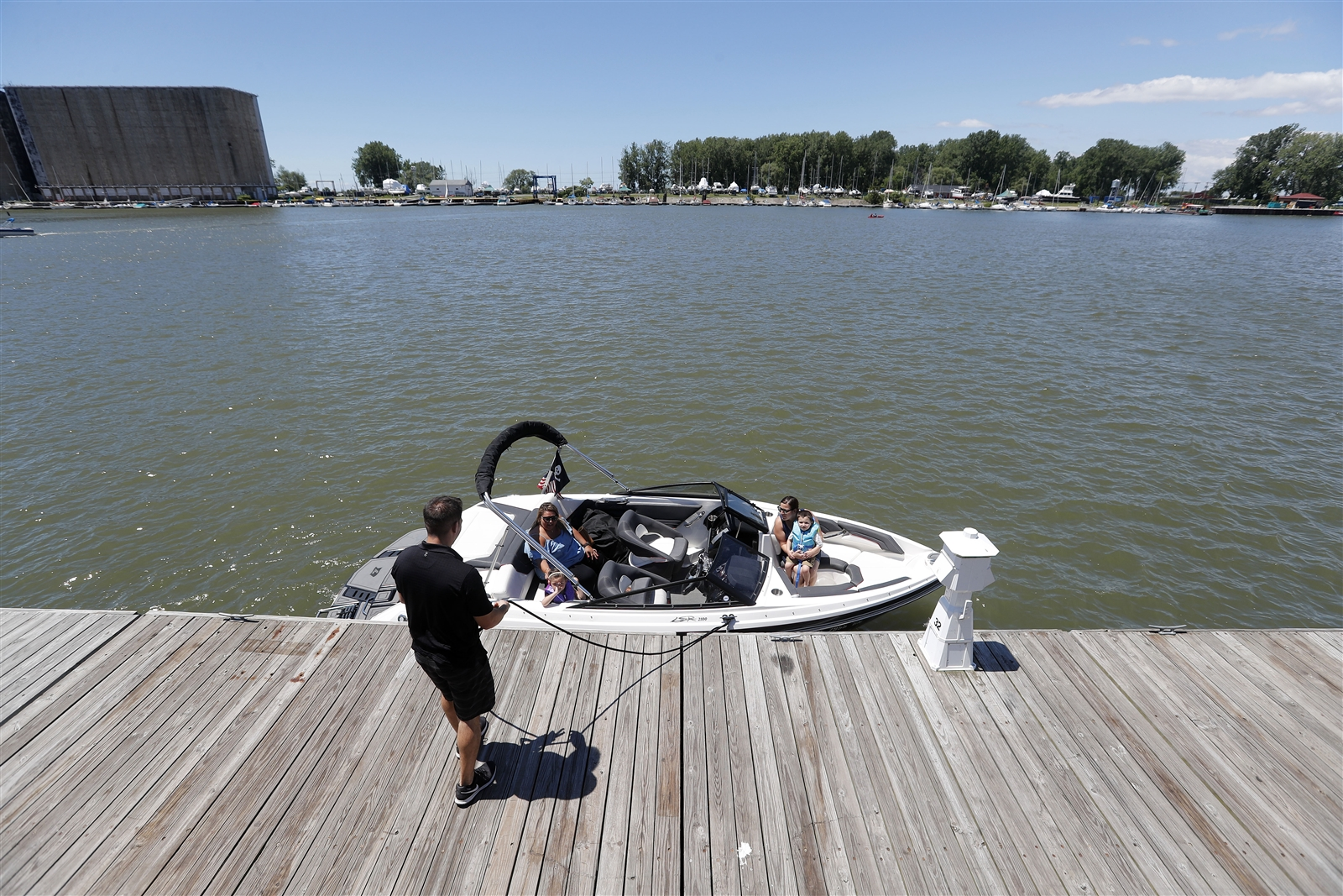 Nick Poblocki unties his boat to take his family out for a ride at Canalside on the official first day of summer in Buffalo Wednesday, June 21, 2017.
