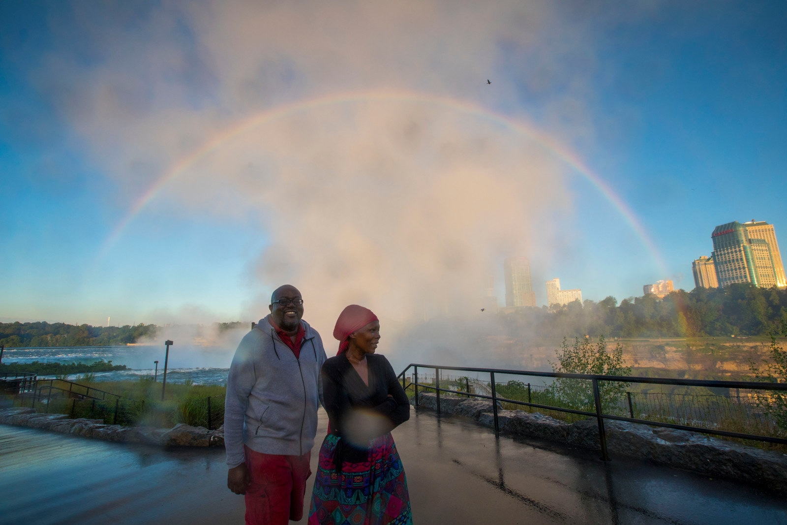 James and Sta Maodzwa, tourists visiting from Zimbabwe, have their own private rainbow at Terrapin Point.