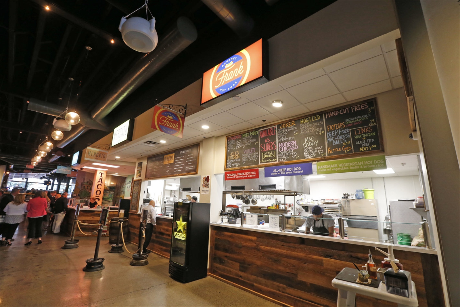 EXPO Market, at 617 Main St. in downtown Buffalo, houses five restaurants and a bar. Pictured is one of the newcomers, Frank Gourmet Hot Dogs.