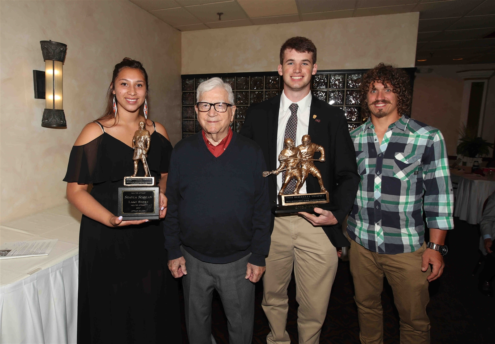 Mark Steenhuis of the Buffalo Bandits (far right) and George Borrelli, father of Tom Borrelli, pose for a picture with the winners of the 2017 Borrelli Awards, given to the top senior lacrosse players in Western New York: Shayla Scanlan of Lake Shore and Jack Lalley of St. Joe's.