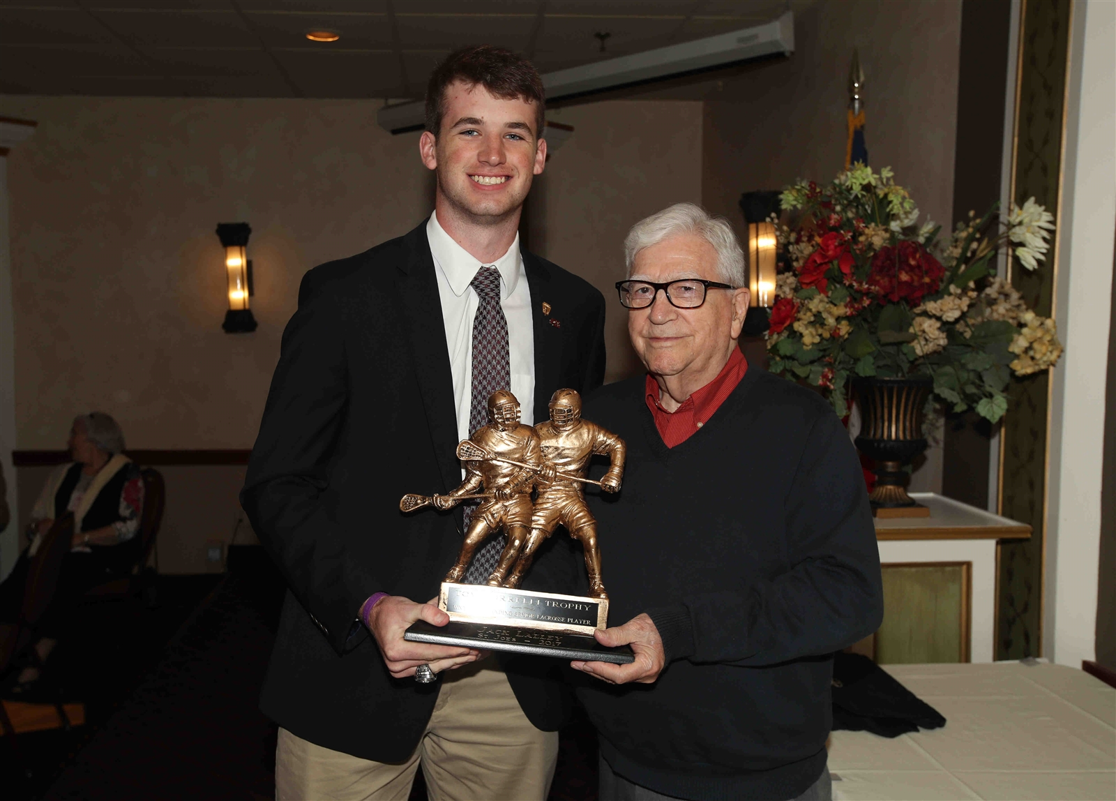 George Borrelli presents the 2017 Borrelli Award for boys lacrosse to Jack Lalley of St. Joe's.