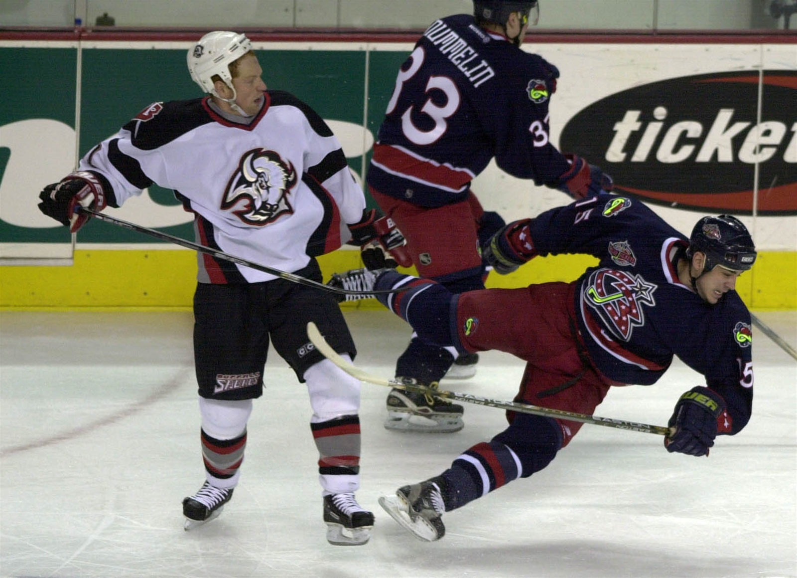 Campbell runs into Columbus' Mike Maneluk during the first period of play in a 2001 game at HSBC Arena.