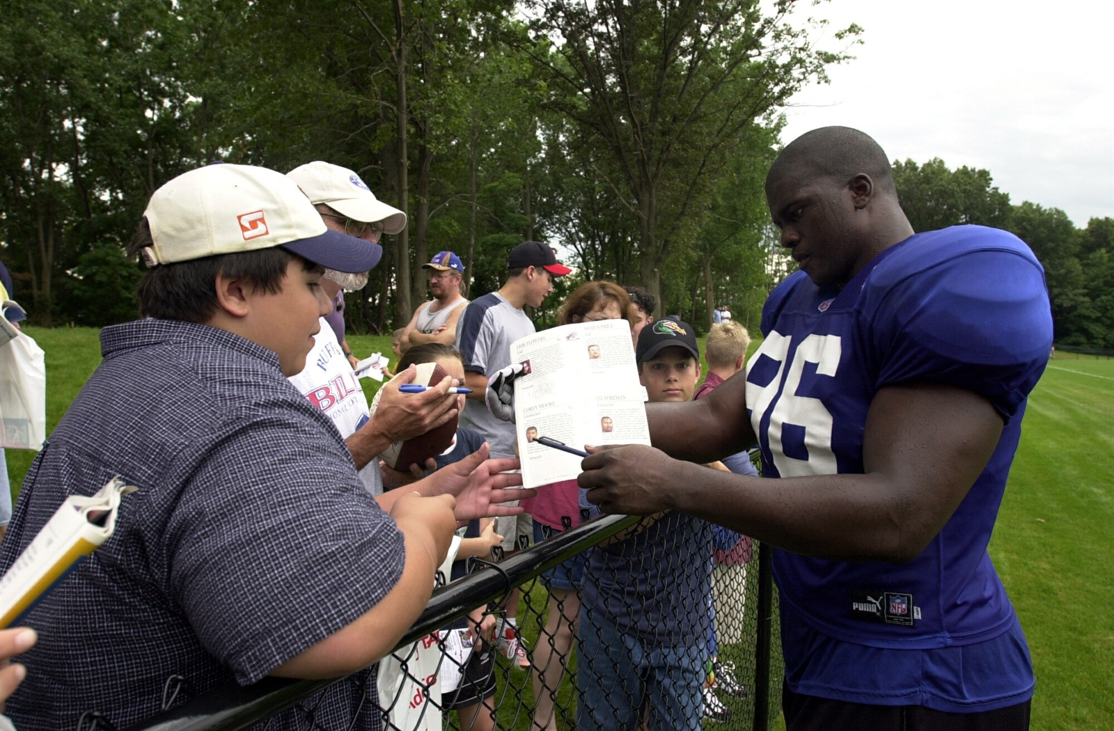 Erik Flowers -- Defensive end; drafted 26th overall in 2000 out of Arizona State. Erik Flowers is seen signing autographs after his first day of Training Camp on July 24, 2000.