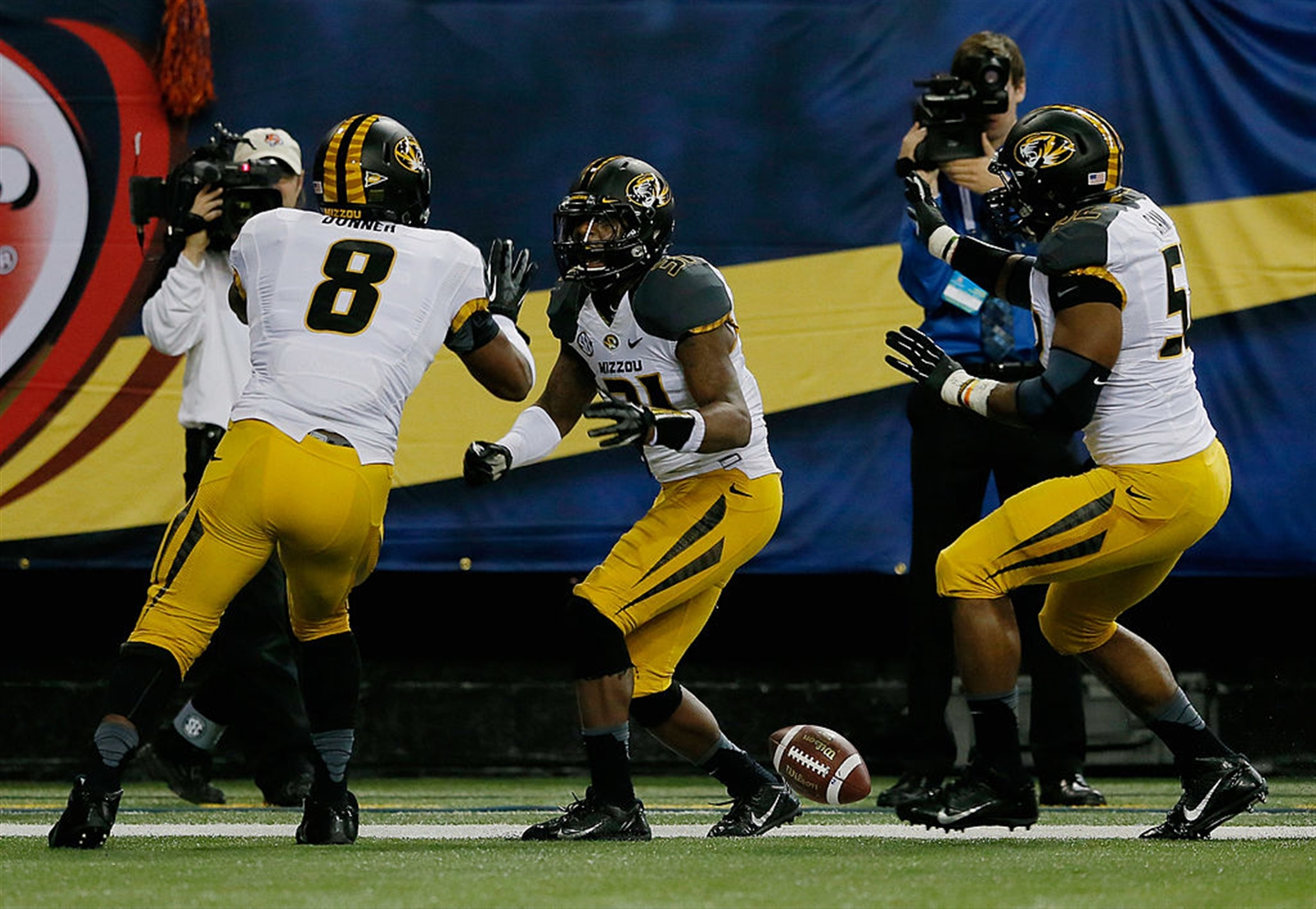 E.J. Gaines of the Missouri Tigers celebrates his second quarter touchdown with teammate Donovan Bonner (8) and Michael Sam (52) against the Auburn Tigers during the SEC Championship Game at Georgia Dome on December 7, 2013 in Atlanta, Georgia.