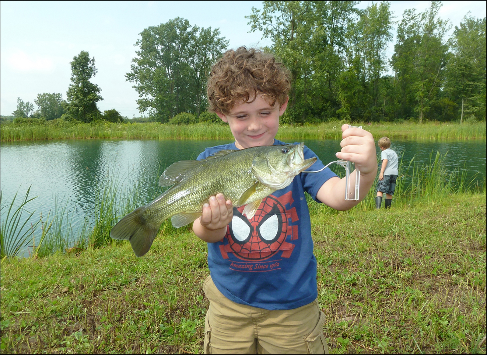 Roger Gough, 4, of Amherst, caught this largemouth bass while fishing with his brother at their grandfather's pond in East Shelby.
