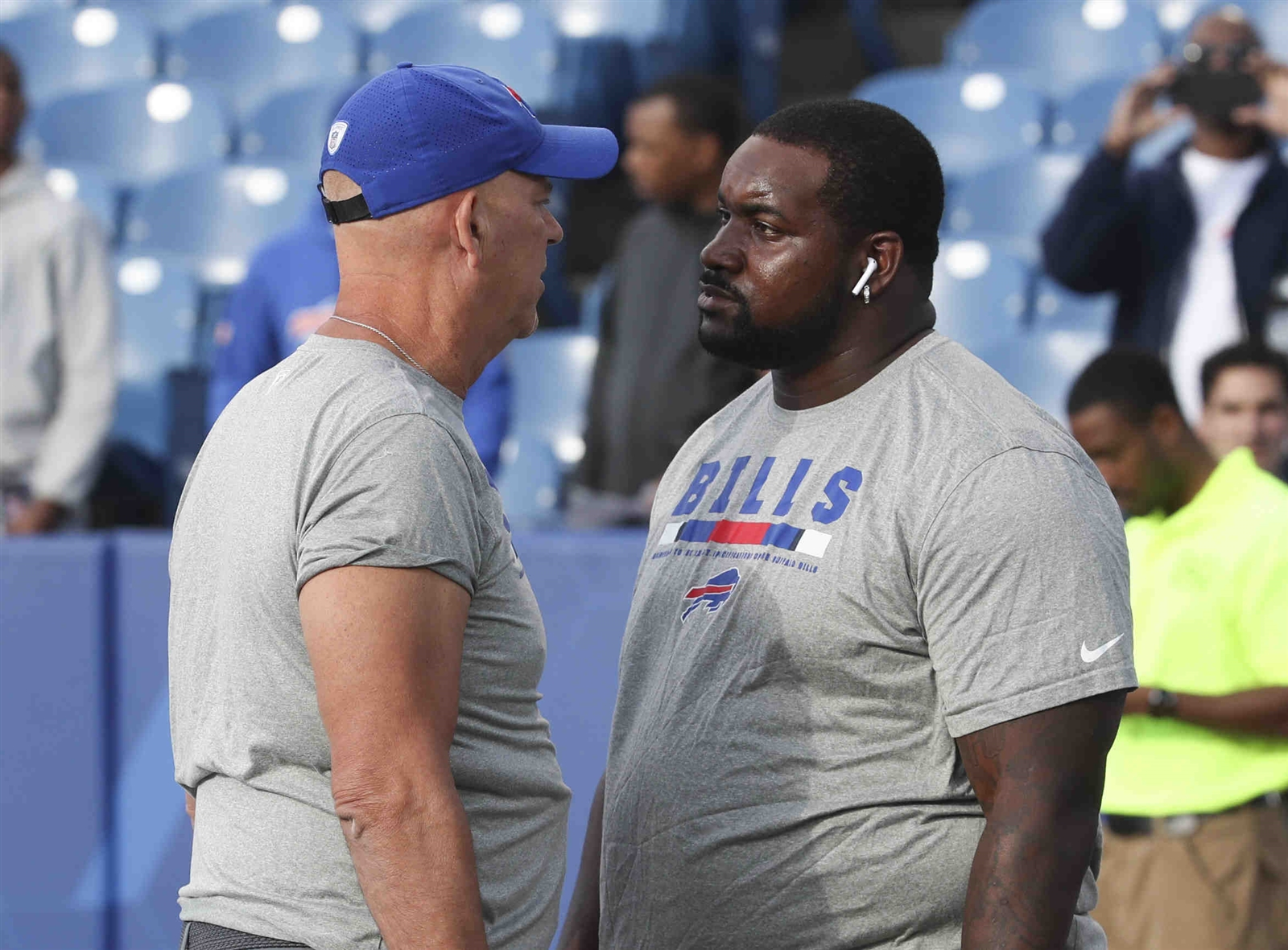 Buffalo Bills nose tackle Marcell Dareus has a talk with  defensive line coach Mike Waufle before the game.