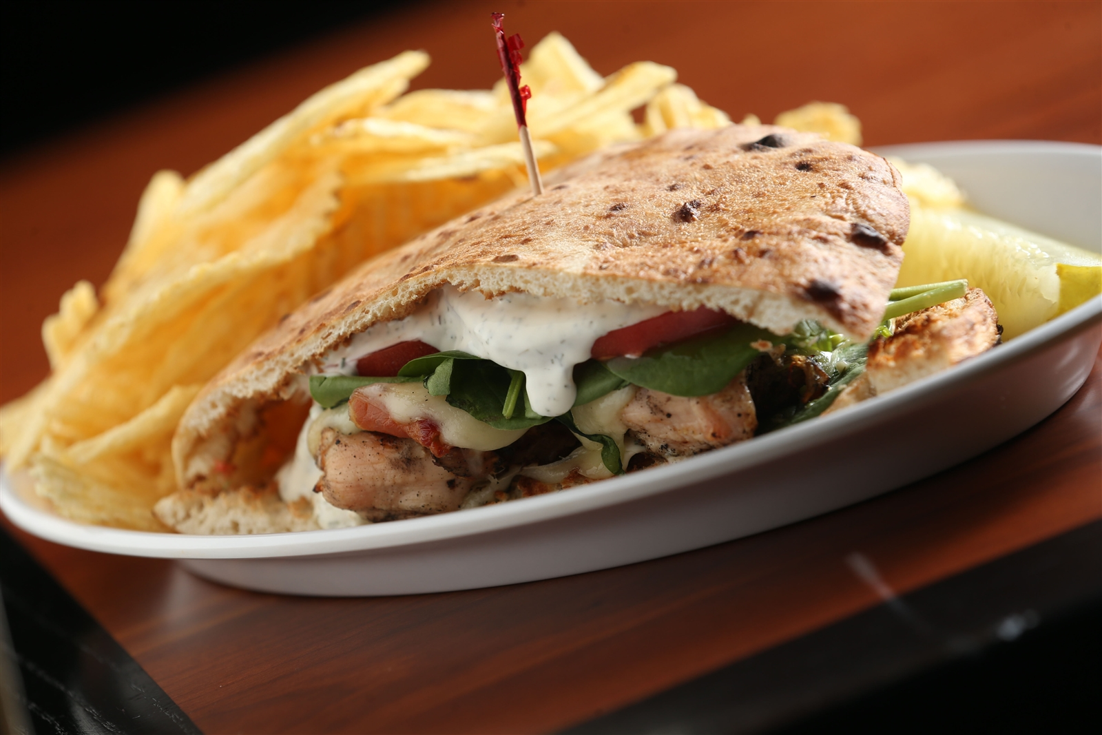 Looking for something more adventurous? Rock Bottom's H.H.S. Hooligan House Special is a chargrilled chicken breast with bacon, melted provolone, fresh spinach, tomato and homemade dill dressing served on fresh pita bread.