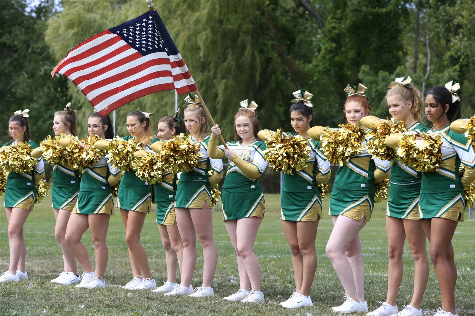 Timon cheerleader Sarah Brown holds the flag for the National Anthem.