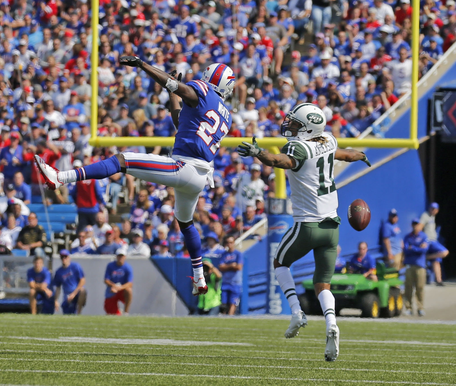 Buffalo's Tre'Davious White gets in Jets' receiver Robby Anderson's face enough to break up his focus for a dropped pass.