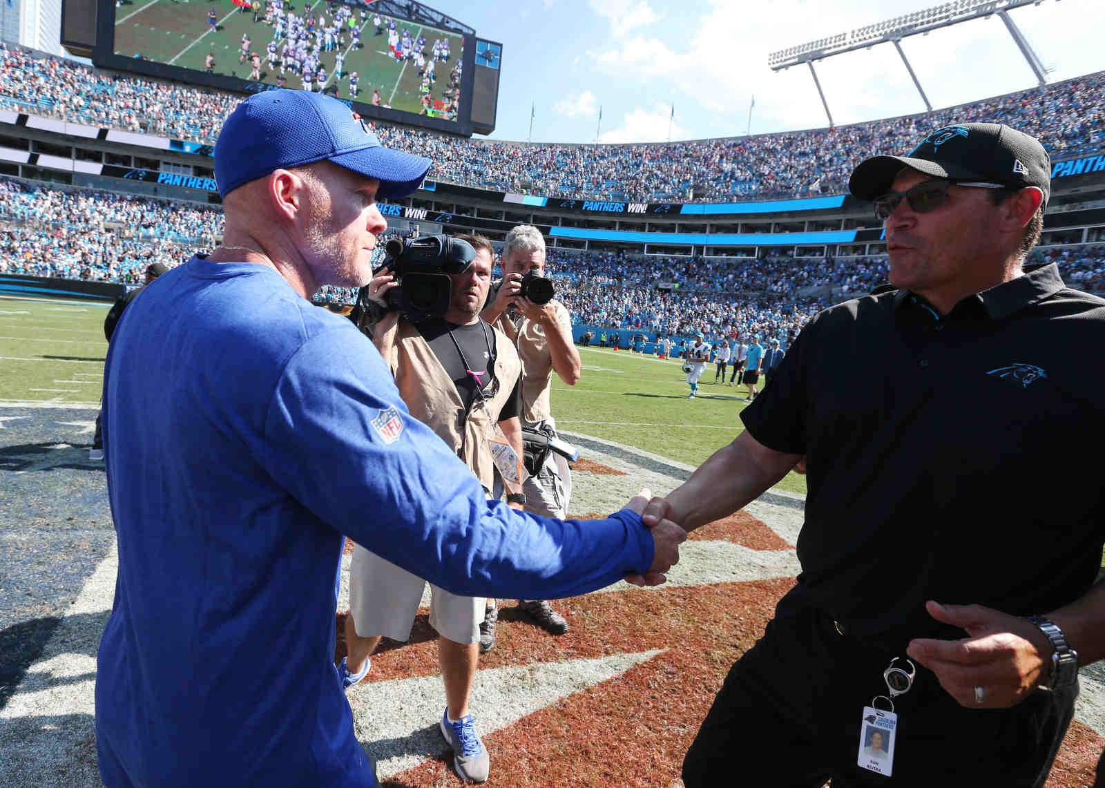 Buffalo Bills head coach Sean McDermott shakes the hand of Carolina Panthers head coach Ron Rivera at the end of the game.