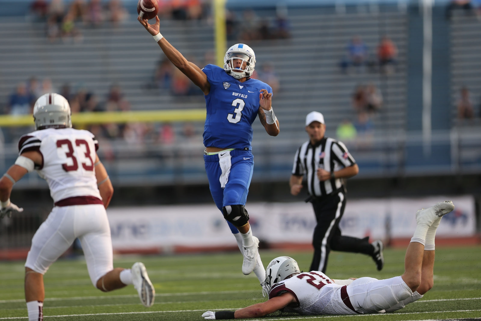 UB quarterback Tyree Jackson (3) throws a pass as he evades Colgate linebacker T.J. Holl.