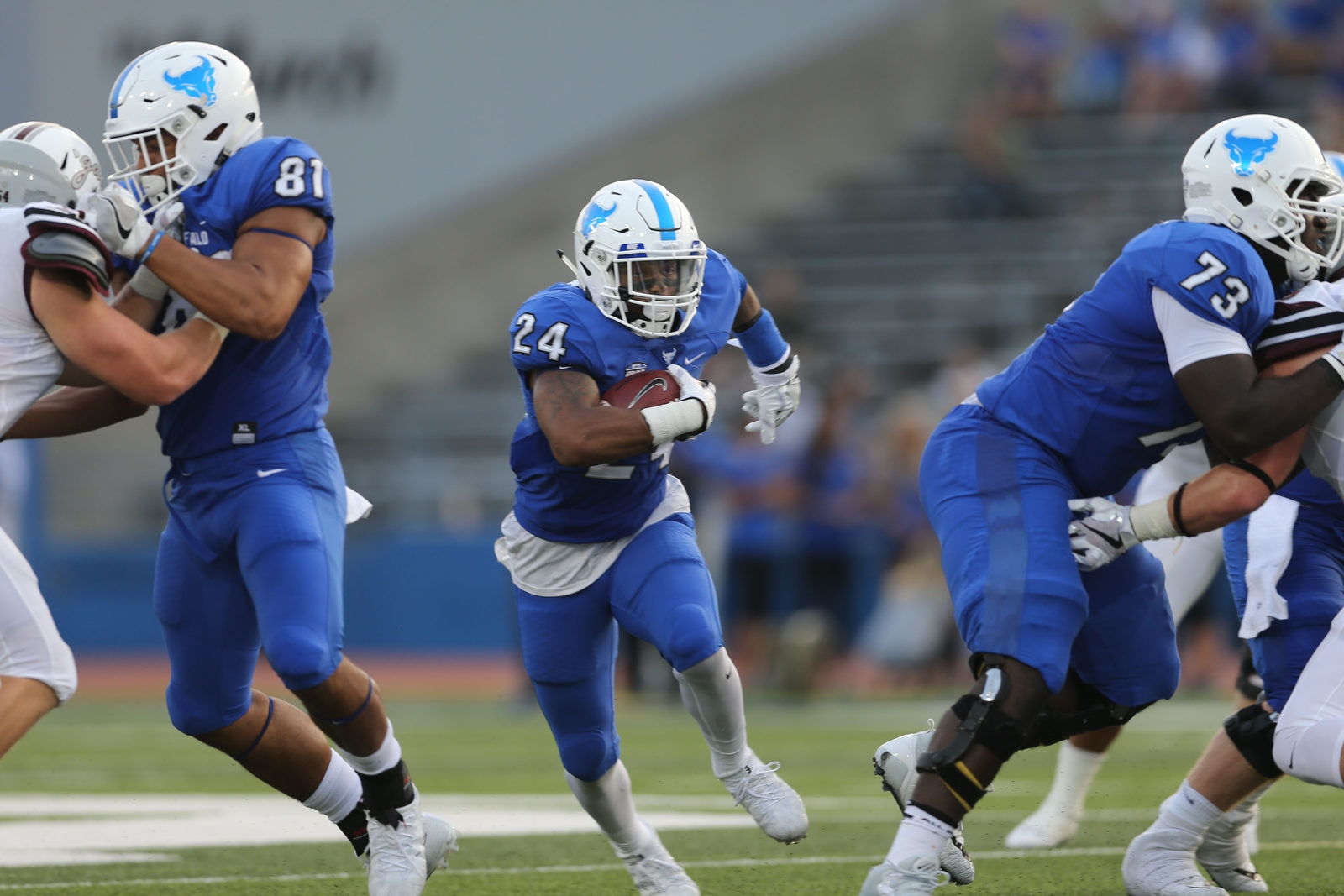 UB running back Johnathan Hawkins (24) finds room to run against Colgate.