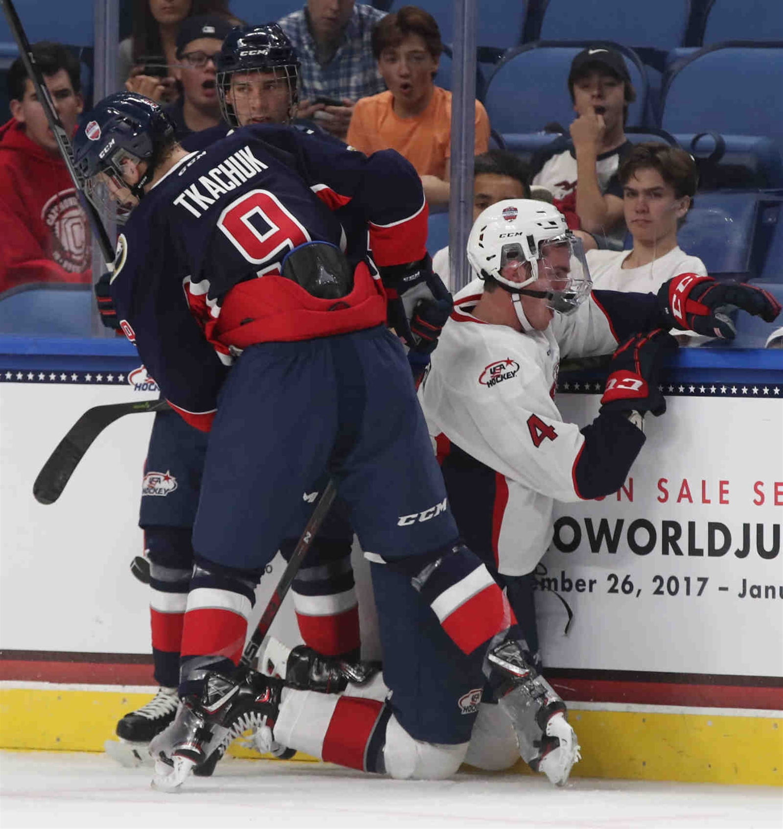 Brady Tkachuk #9 of Team Leetch hammers Cole Krygier #4 of Team Chelios into the boards at the end of the first period at KeyBank Center in Buffalo on Thursday, Sept. 21, 2017.