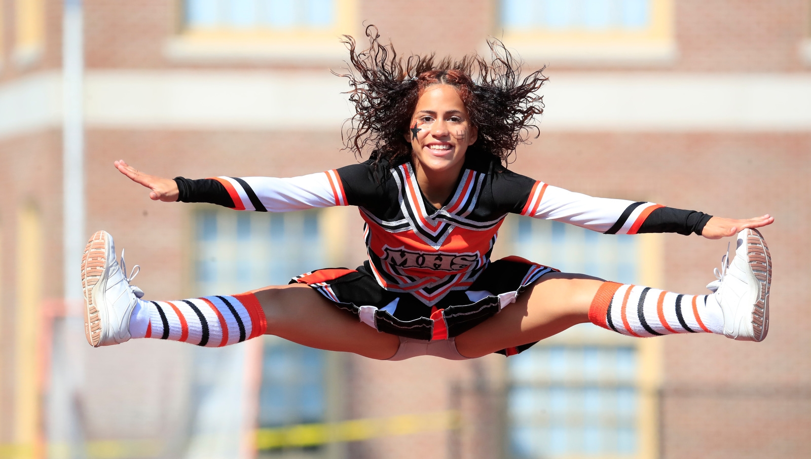 McKinley cheerleader Destiny Pagon jumps during first half action against South Park at Robert E. Rich All High Stadium on Saturday, Sept. 23, 2017.