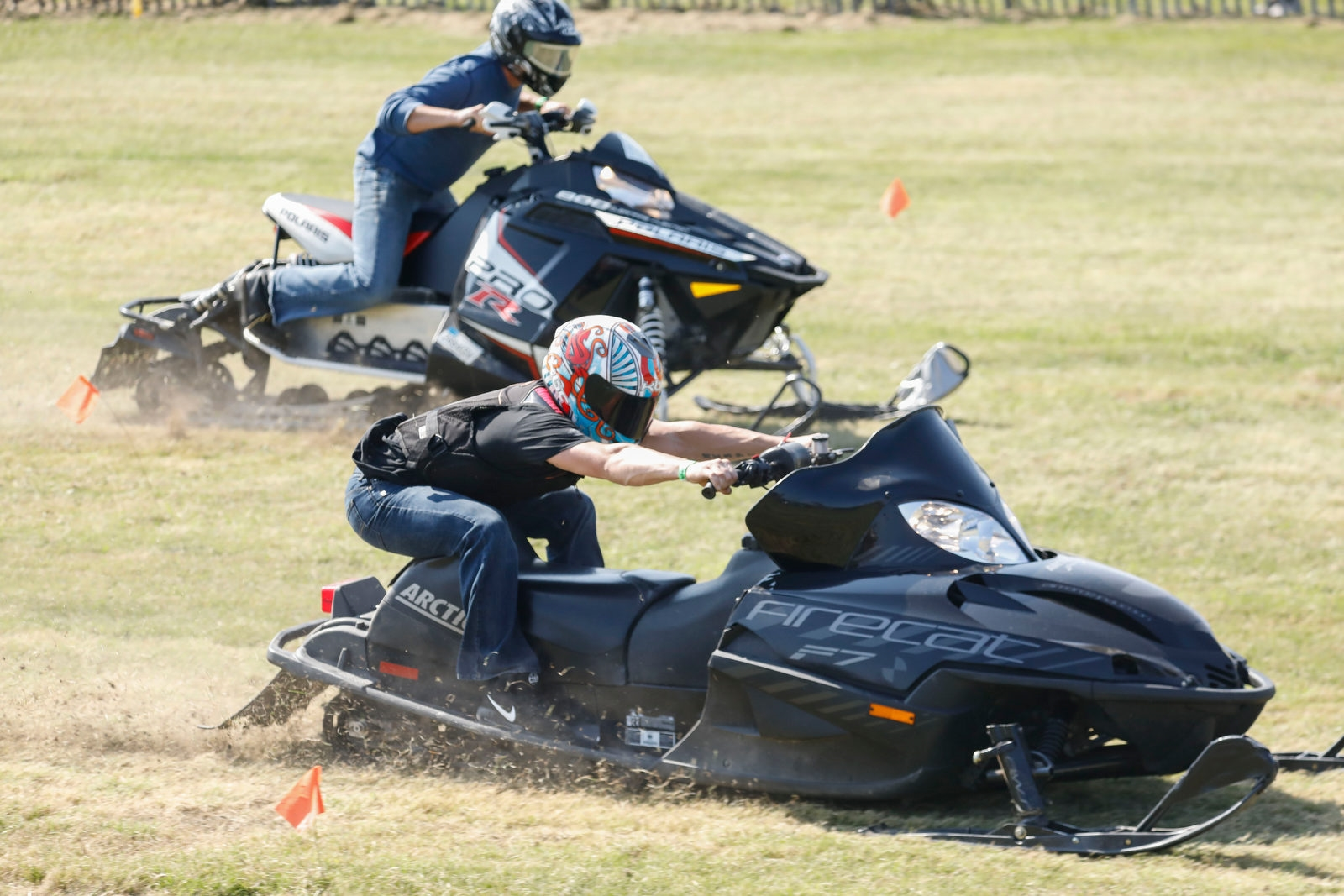 90-degree weather turned out to be just fine for the Shawnee Sno-Chiefs Snowmobile Club's annual Grass Drags, as Paul Spry of Penfield, right, has a jump on his competition.  While snow wasn't ever expected, this was the warmest weather they've ever had for the event.