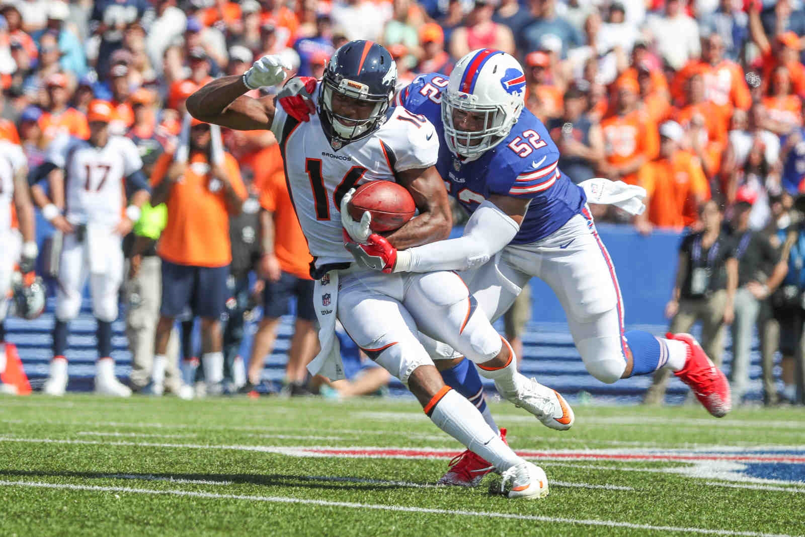Buffalo Bills linebacker Preston Brown (52) tackles Denver Broncos wide receiver Bennie Fowler III (16) in the first quarter.