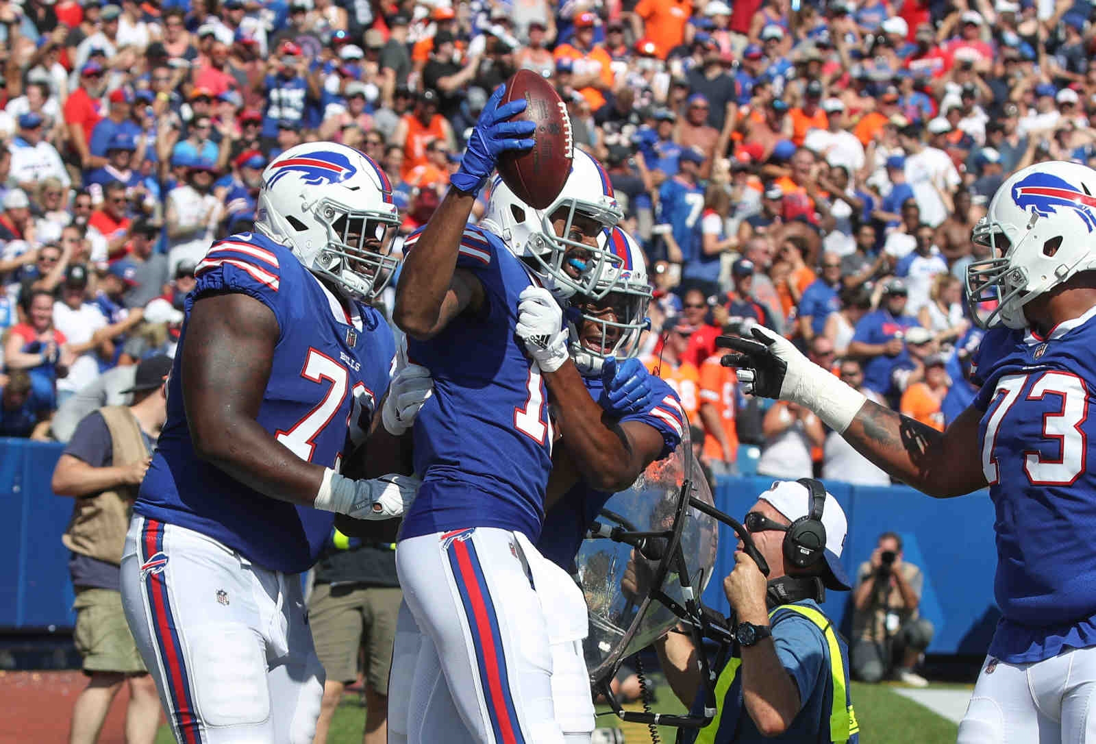 Buffalo Bills wide receiver Andre Holmes (18) celebrates his touchdown against the Broncos with teammates in the second quarter.