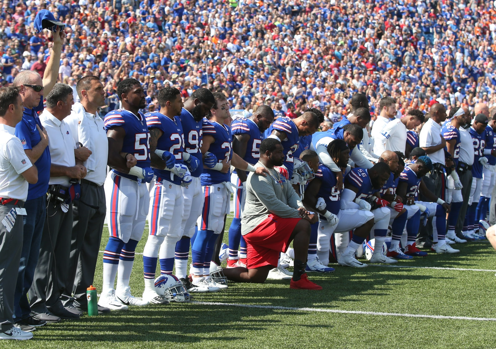 Bills Hall of Fame QB Jim Kelly raises his hand while several Buffalo Bills players take a knee during the national anthem before the start of the game against the Denver Broncos at New Era Field in Orchard Park on Sunday, Sept. 24, 2017.