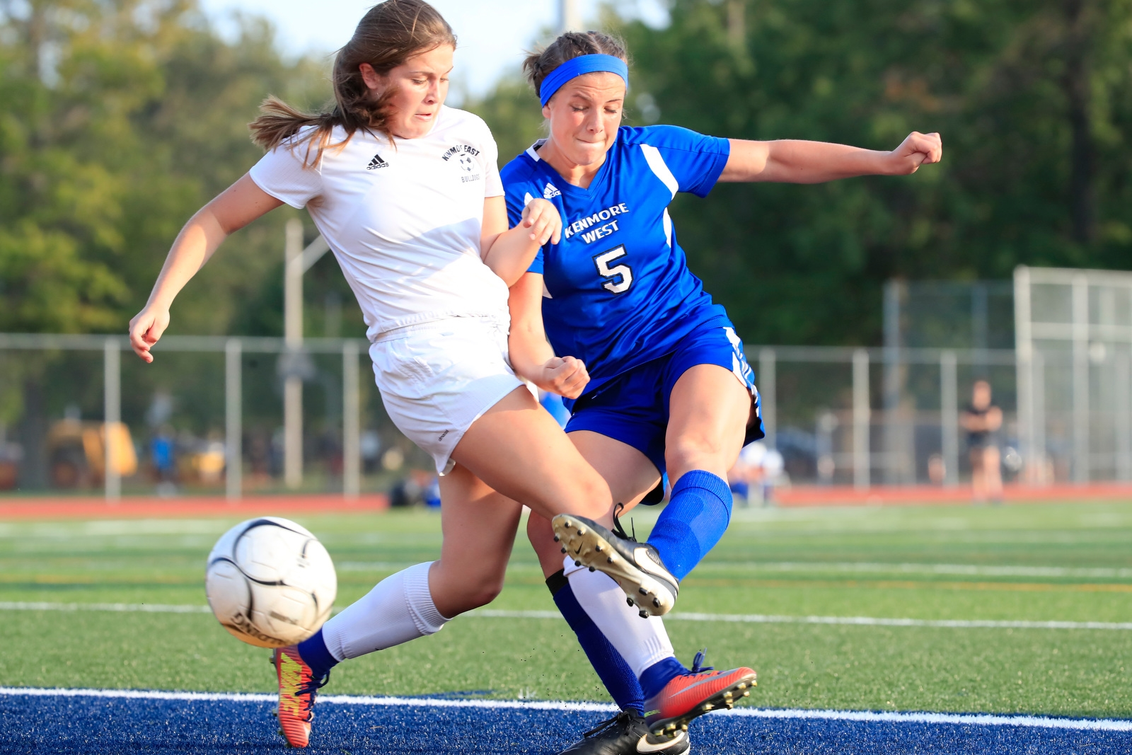 Kenmore Westu2019s Molly Tobin kicks a ball around Kenmore Eastu2019s Emily Dellapenta during first half action at Adams Field on Monday, Sept. 25, 2017.