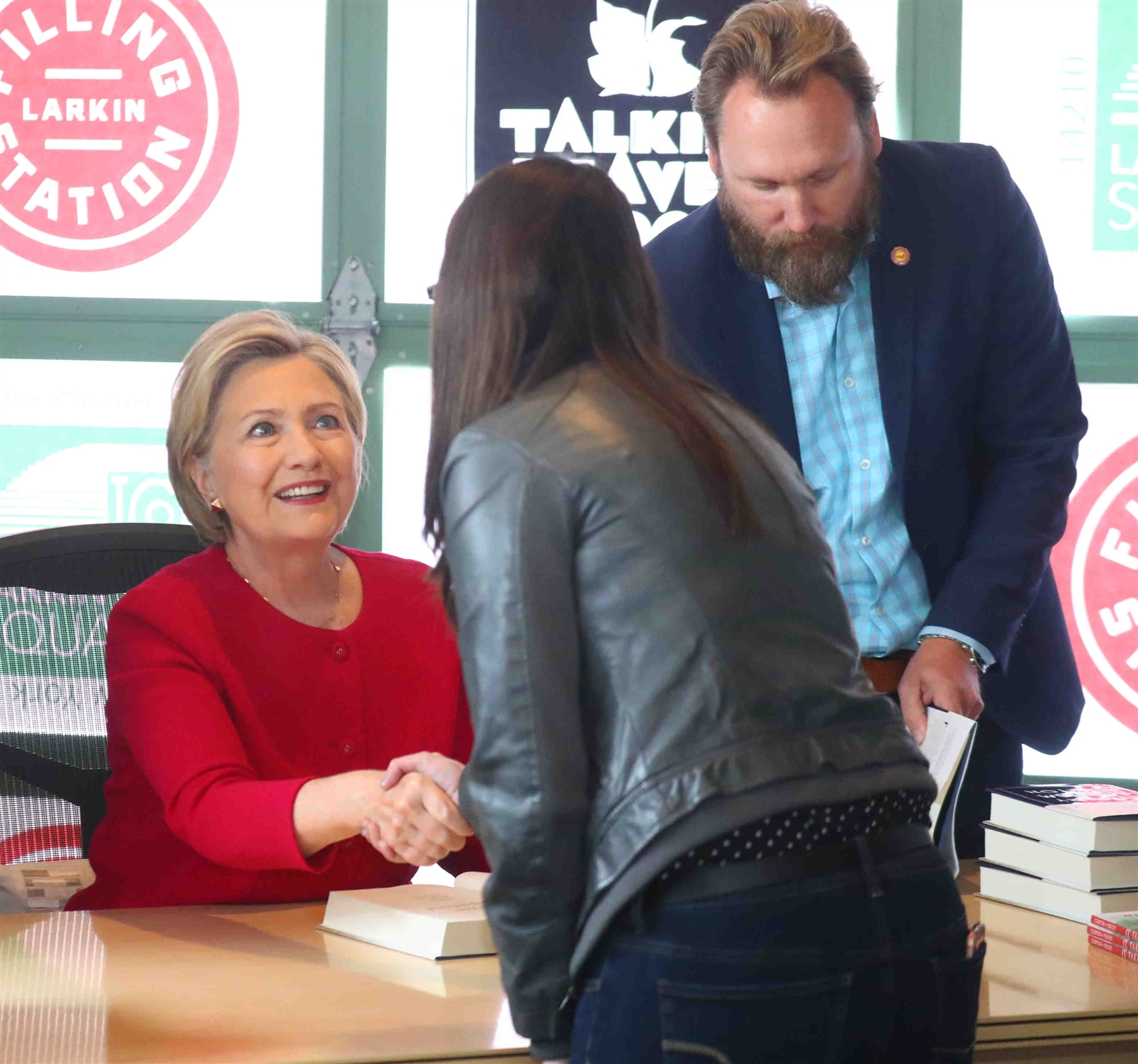 Hillary Clinton greets a woman.